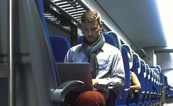 man traveling with laptop